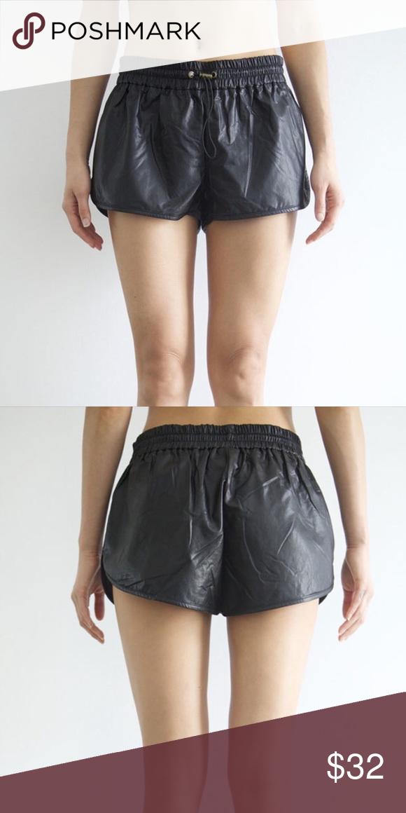 Black leather-like shorts NWOT. Feels like buttery leather! Super versatile, smooth, light, sleek, and neat. Bet you don't have a pair of black shorts like them. Size M can fit a size 6-8 easily. TAGGED TOPSHOP FOR VIEWS ONLY Topshop Shorts