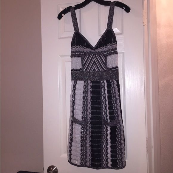 bebe Vintage Shimmery Dress Gorgeous dress by bebe. Never worn only tried on. Sewing is slightly coming apart on one strap but it's an easy fix. I'll even fix it for you if you want. Rare and hard to find. Other than that it's in great condition. No trades or offers please. bebe Dresses
