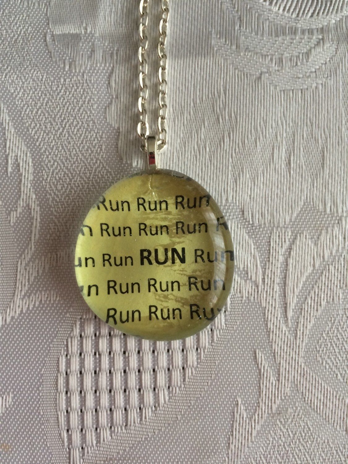 A personal favorite from my Etsy shop https://www.etsy.com/listing/224110070/running-art-glass-pendant-necklace-run