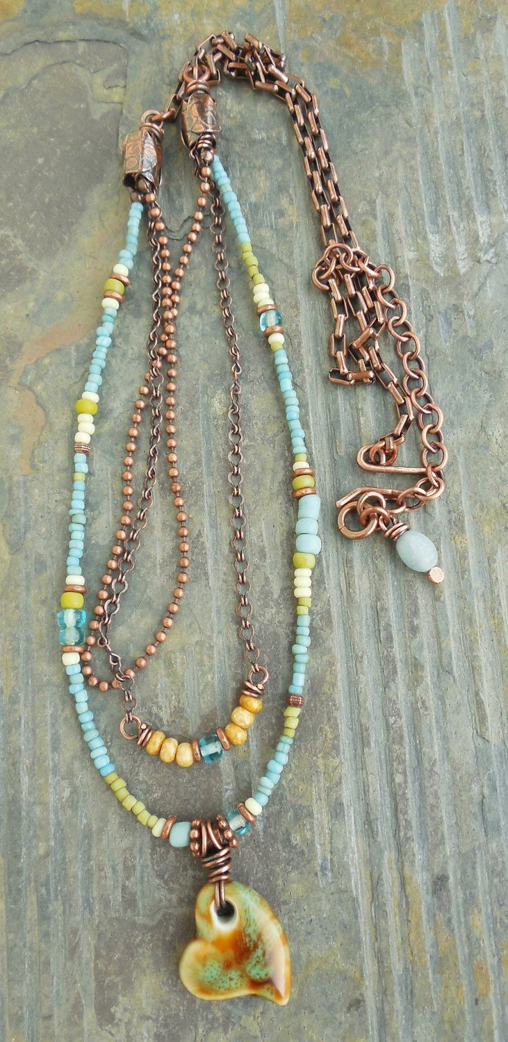 I designed this little three-strand necklace in a slightly longer length, to be worn layered with your favorite shorter pendants or chains. I started