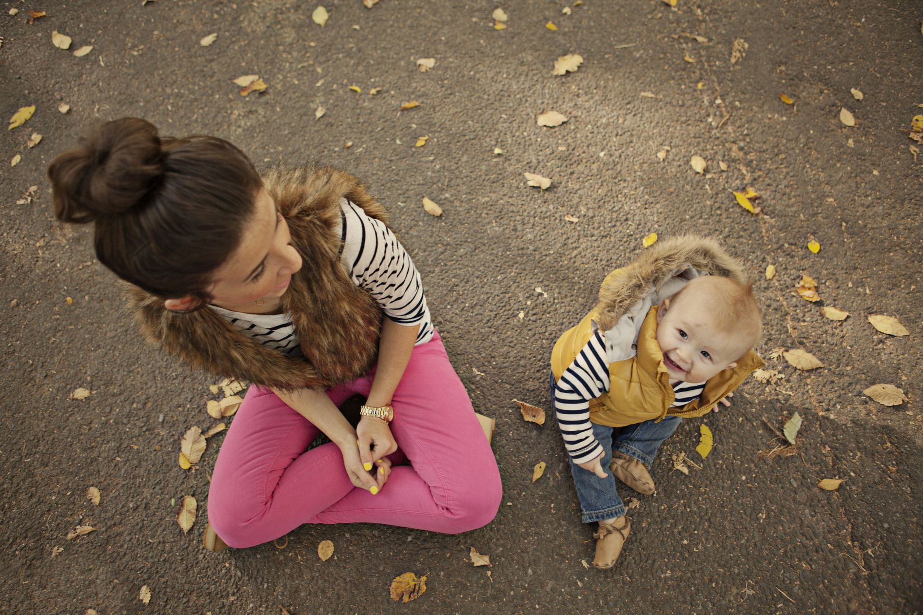 I love her outfit. Pink jeans, striped shirt, fur vest, and top knot! And the baby is sooo cute!