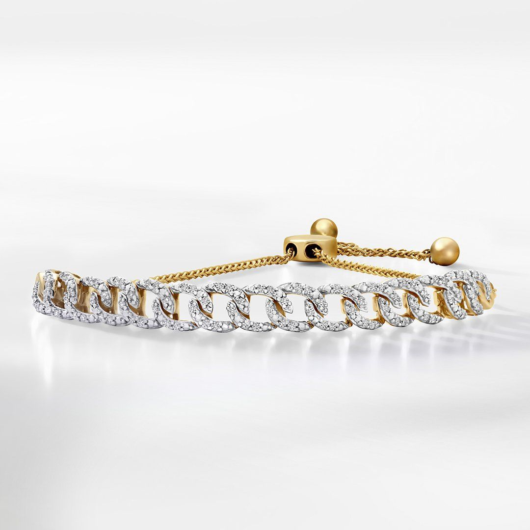 d2072e076 This yellow gold diamond chain link bolo bracelet will make it easy to  stack on style.