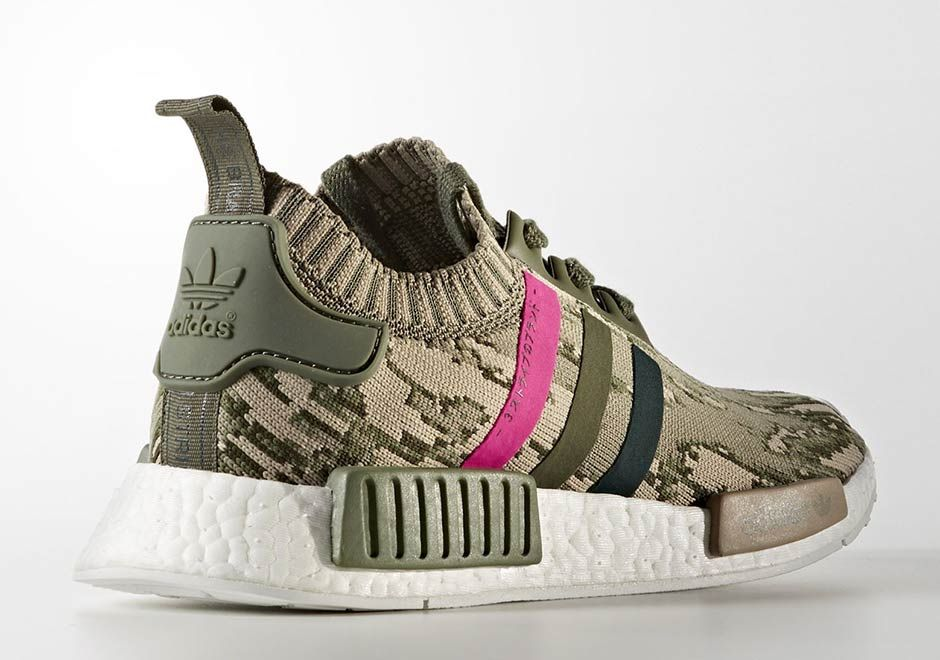 pretty nice 904a3 2d962 The adidas NMD R1 is about to drop in one of its most unique looks of the  year, which combines a camo-patterned Primeknit upper with tri-color  stripes.