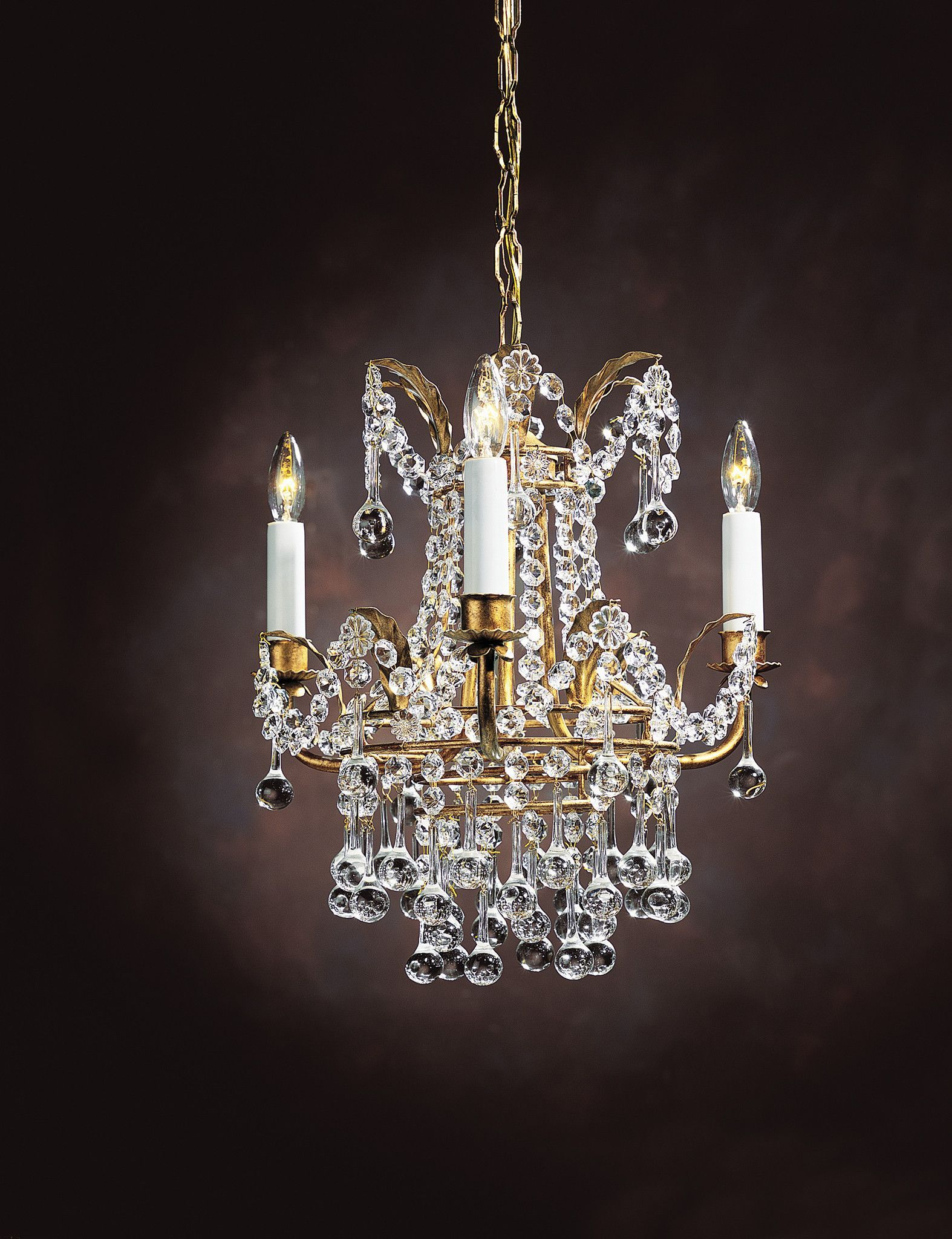 Three-light crystal chandelier on an iron frame with antiqued gold leaf. Hand…