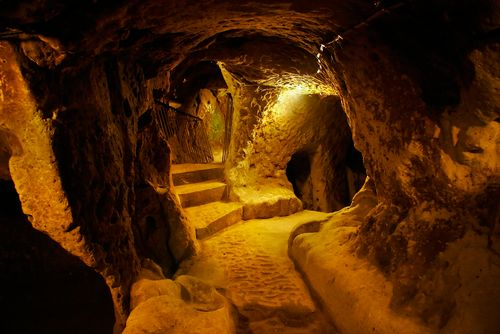 The Foundations of Cappadocia, Turkey.  The ancient underground city of Derinkuyu has seven descending levels making it one of the largest underground complexes known. These levels let people live everyday lives with churches and schools and even winery's to help support the large population.