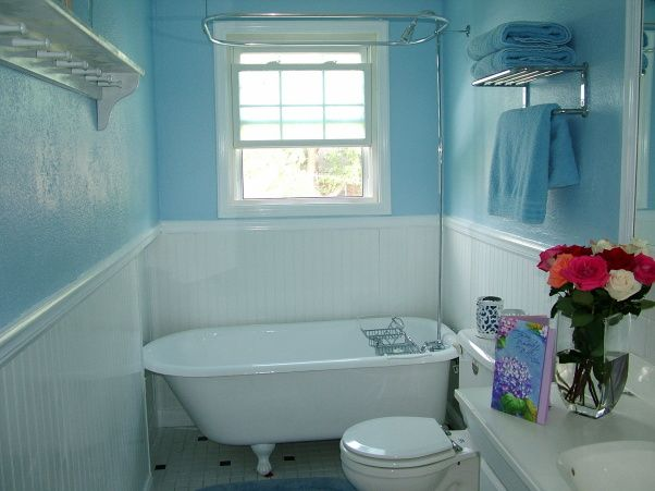 small blue white bathroom with clawfoot tub we found an old clawfoot tub refinished it the crown molding isnt up yet but will be soon