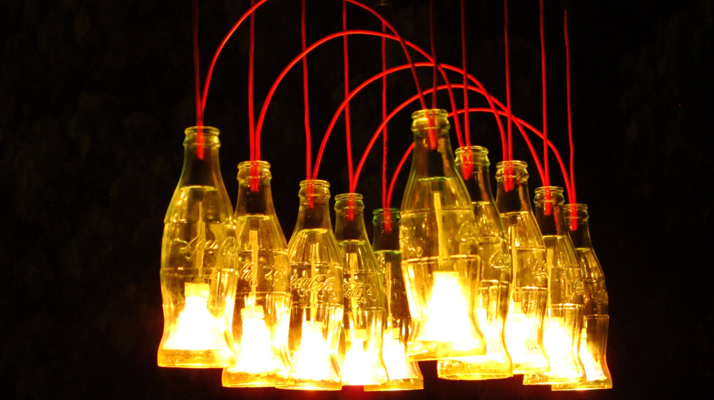 Recycled coca cola bottles made into a chandelier diy pipepallet make a coca cola chandelier with recycled bottles arubaitofo Choice Image