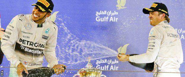 Lewis Hamilton and Nico Rosberg celebrate on the podium at the Bahrain GP