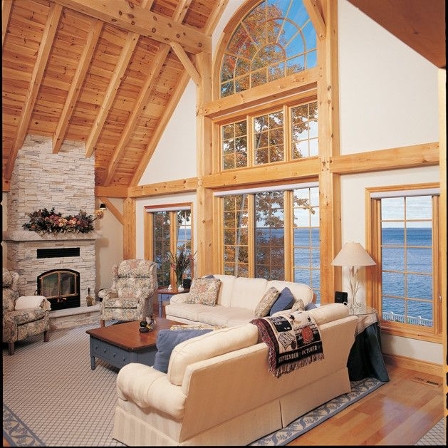 A stone fireplace and traditional timber frame design. Photo ... on home stairway designs, home loft designs, home study designs, home man cave designs, home office designs, home fireplace designs, home walk in shower designs, home workshop designs, home foyer designs, home business designs, home deck designs, home porch designs, home entrance way designs, home bar designs, home garage designs, home studio designs, home patio designs, home pantry designs, home library designs, home great room designs,