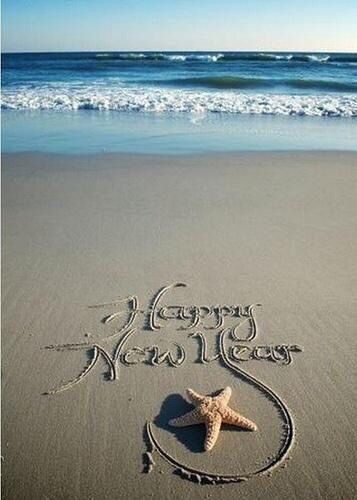 happy new year write your message in the sand take a photo and email it to your friends this year