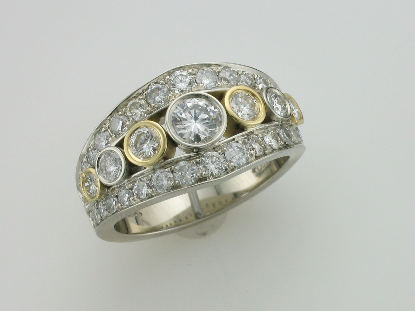 Custom made diamond ring by wong kenus jewellery in calgary ab