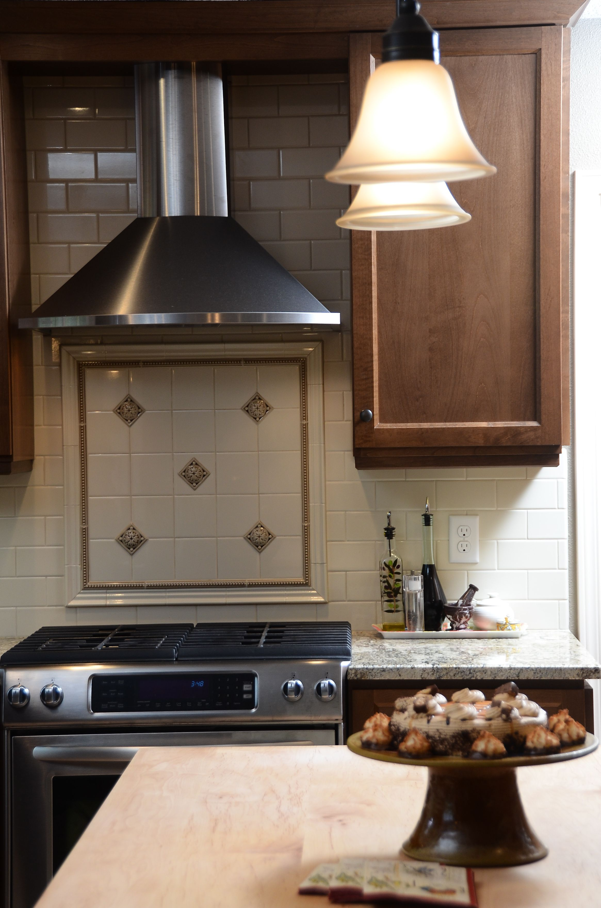 Subway Tile Backsplash With Square Tile Rug Behind Range With