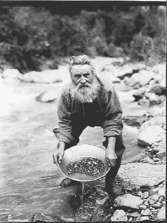 June 4, 1911 Gold was discovered in Alaska's Indian Creek. Here we see a miner panning for gold.