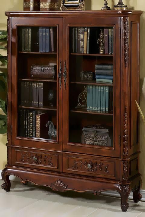 The beautiful antique bookcase, it's dark red wood polished to a glass  finish is covered in ornate carvings, glass doors to protect the first  edition books ... - The Beautiful Antique Bookcase, It's Dark Red Wood Polished To A