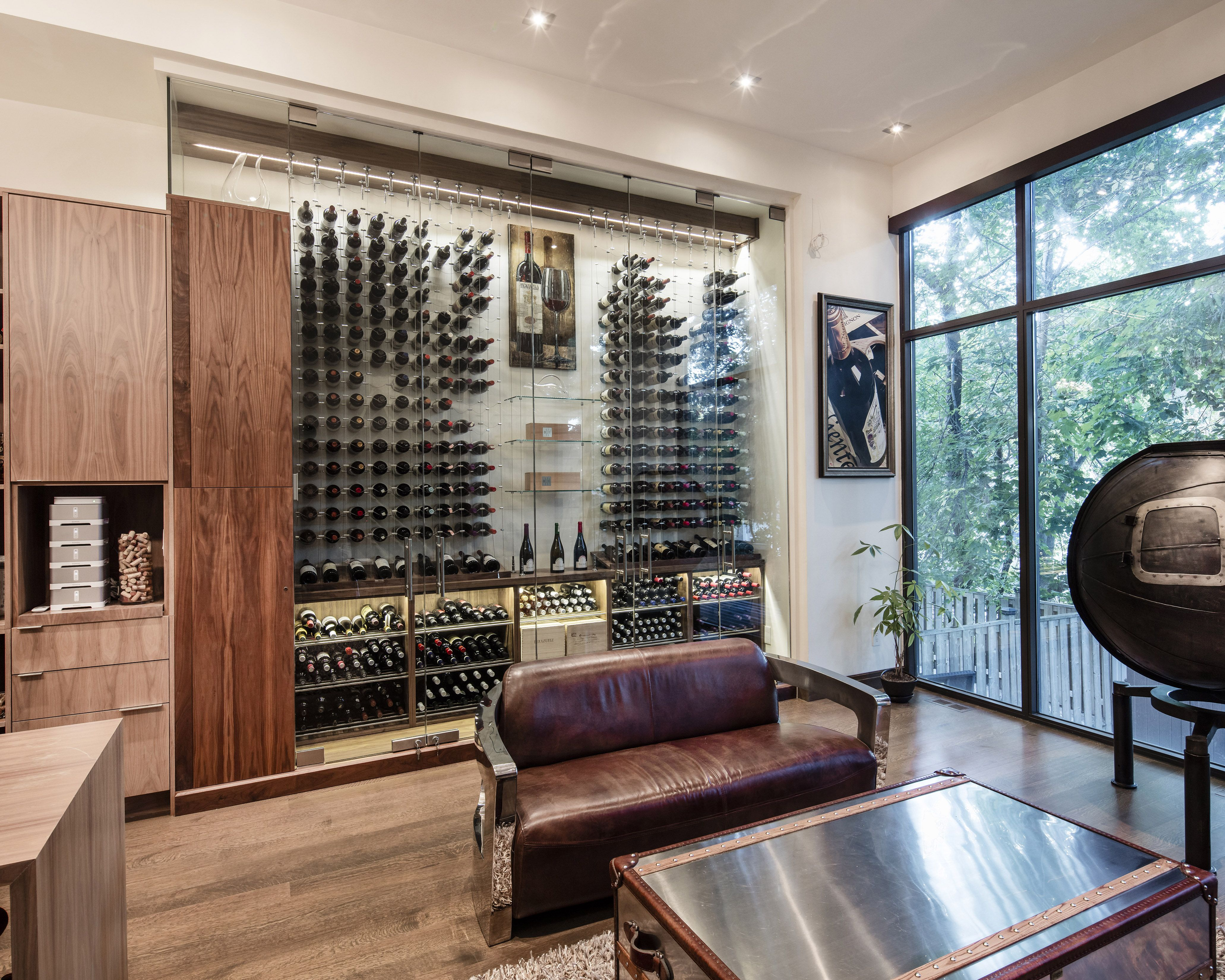 Modern custom reach in wine cellar featuring the Cable Wine System ...