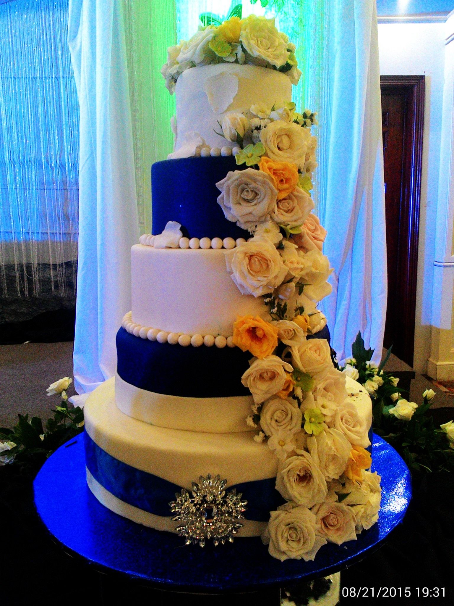 Wedding cake with cascading sugar paste flowers moist chocolate