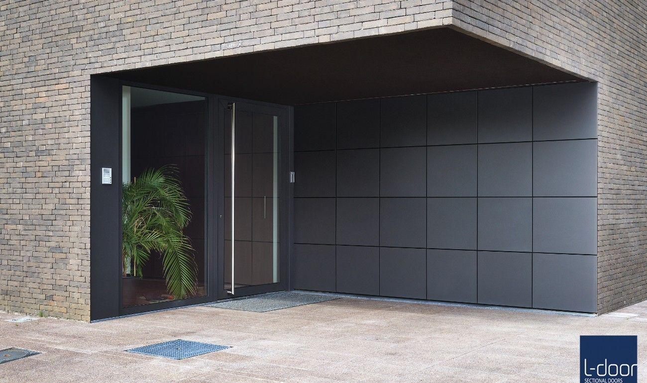 Good L Door Puma Line STX Facade Sectional Garage Door With Rockpanel Cladding.