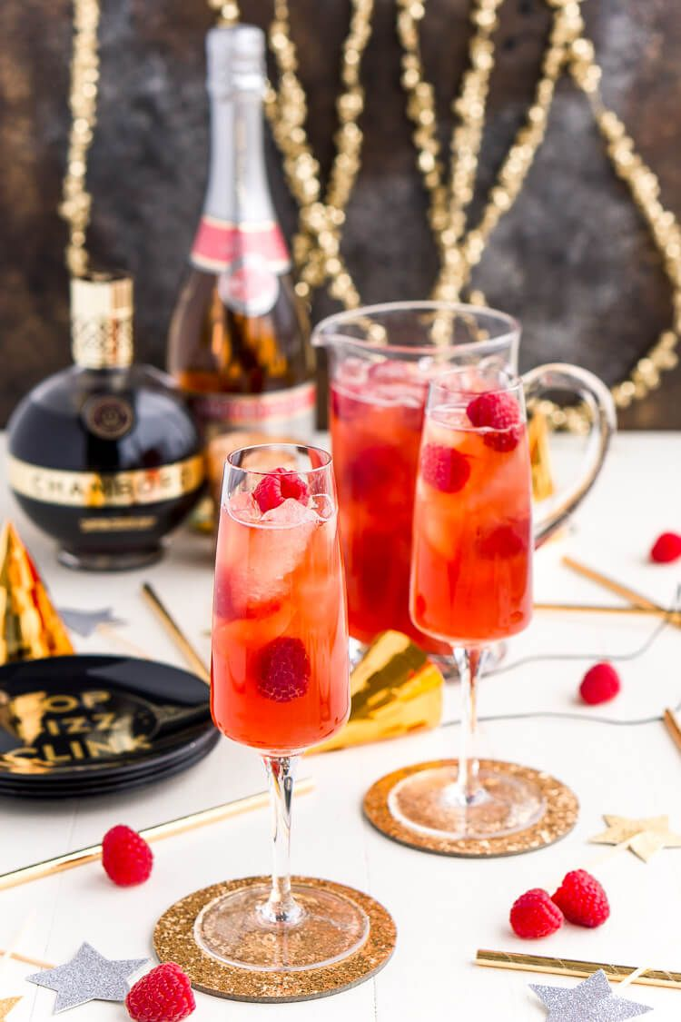 New Year S Eve Champagne Punch Is Loaded With Triple Sec Blackberry Brandy Chambord Pineapple Juice G Champagne Punch Recipes Champagne Punch Punch Recipes