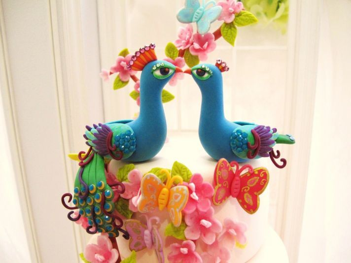 bright peacock wedding cake toppers