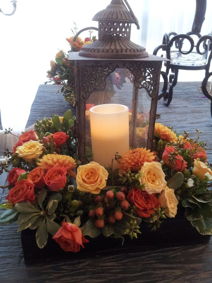 Fall wedding centerpieces with lanterns via kaitie