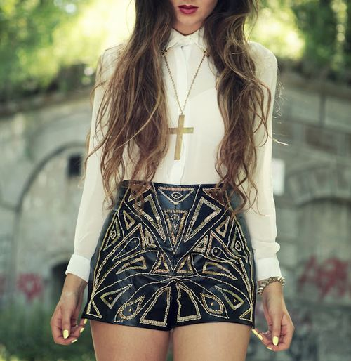 Black shorts with glittery gold detail, white blouse and cross necklace.  Love this x
