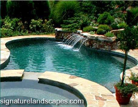 Swimming Pool Waterfall From Spa Jpg Jpeg Image 454x353 Pixels Swimming Pool Waterfall Pool Waterfall Swimming Pool Designs