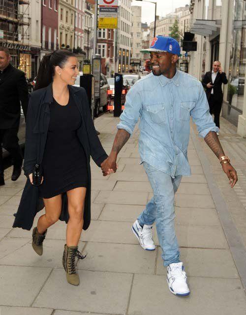 a39684b31baa54 ... Kanye West Photos - Reality star Kim Kardashian walks hand-in-hand with  her ...