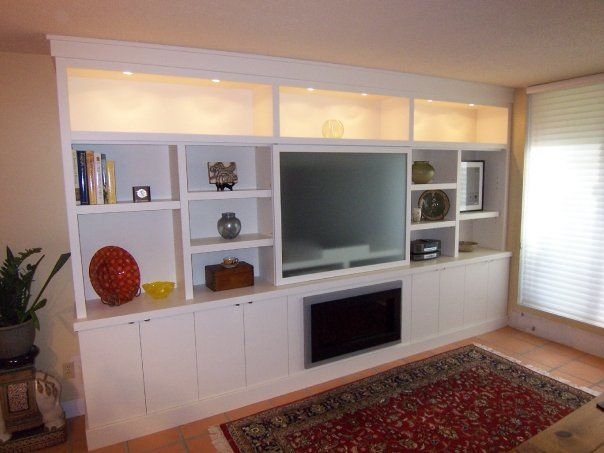 wall cabinets living room | upper display cabinets with puck lights, and  lower storage with