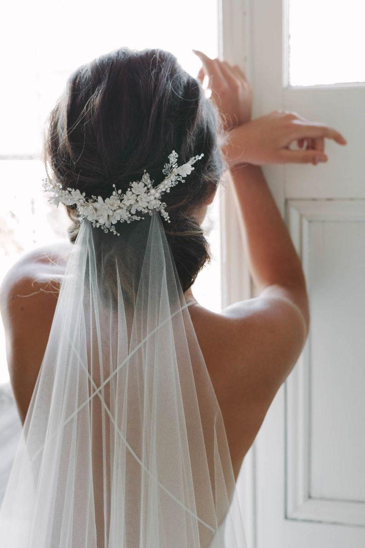 honeysuckle flowers on this lovely crystal pearl bridal hair