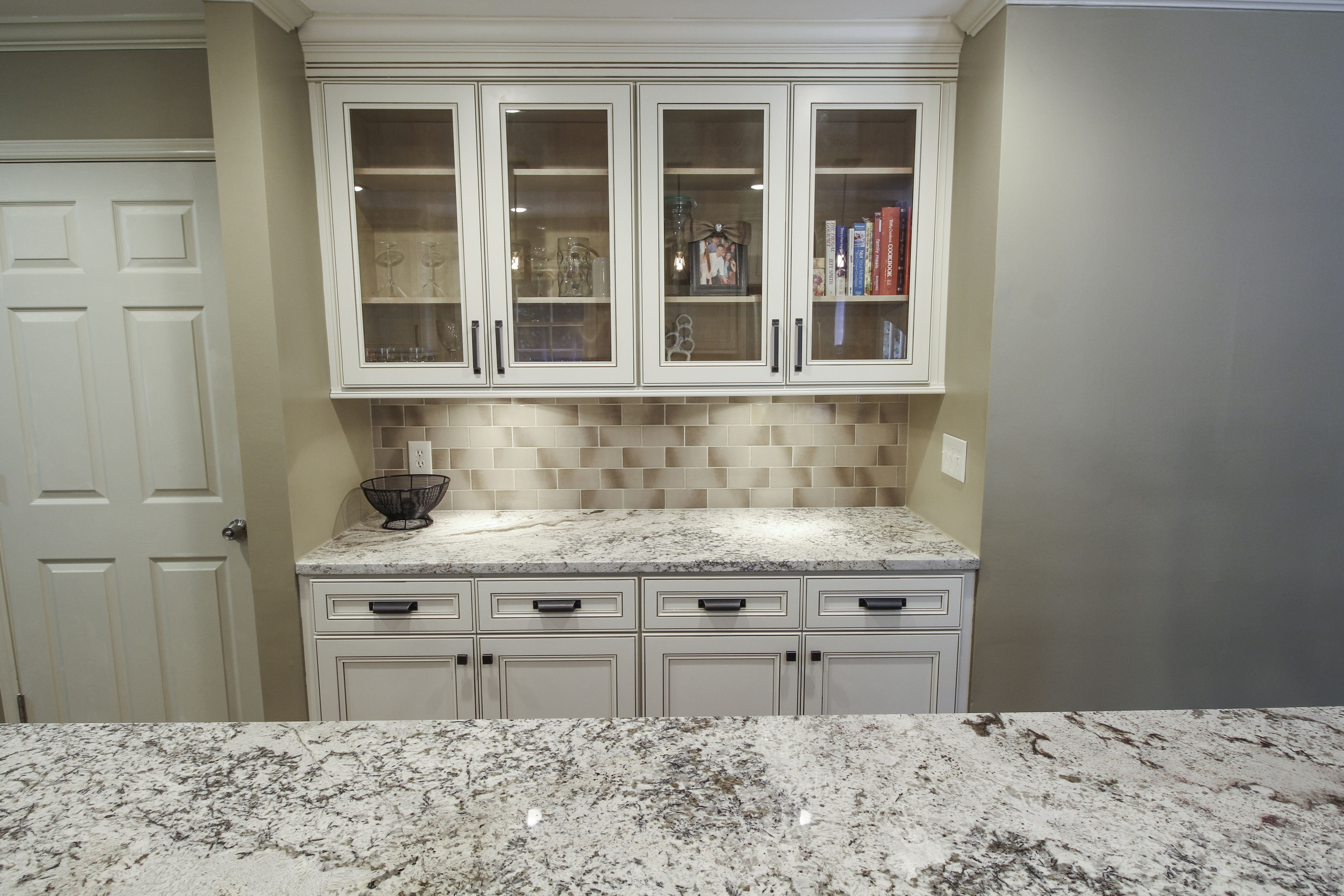 Custom Built Buffet With Glass Cabinets Granite Countertops And Subway Tile Kitchen Remodel Kitchen Design Beautiful Kitchens