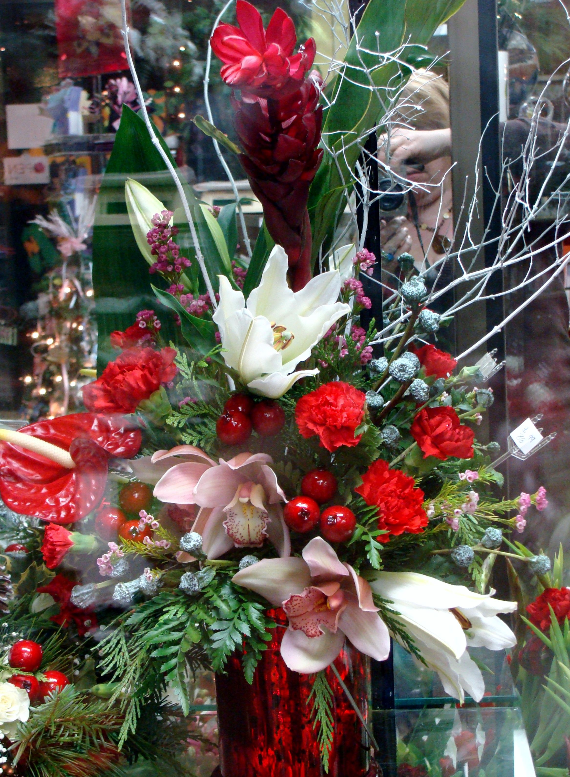 Christmas arrangement filled with ginger lilies and Christmas orchid arrangements
