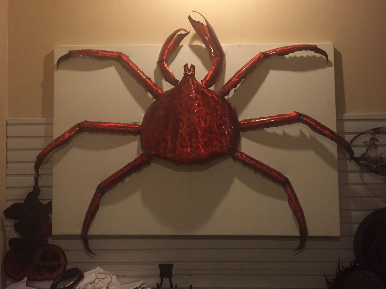Monster king crab. Plasma cut hand and hammer formed out of 1/8 aluminum plate. Air brushed with dyes. Mounted on 5' x 4' vinyl frame