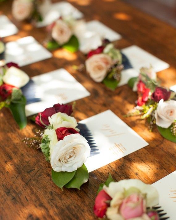 guests at this bridal shower were greeted with flower combs the florist worked with chinese inspired pink and red blossoms to create the combs