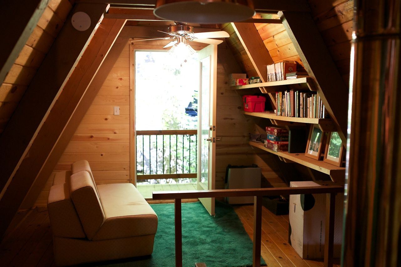 The rare A-frame that actually looks inviting... A-frame cabin built in 1968 in the woods of...