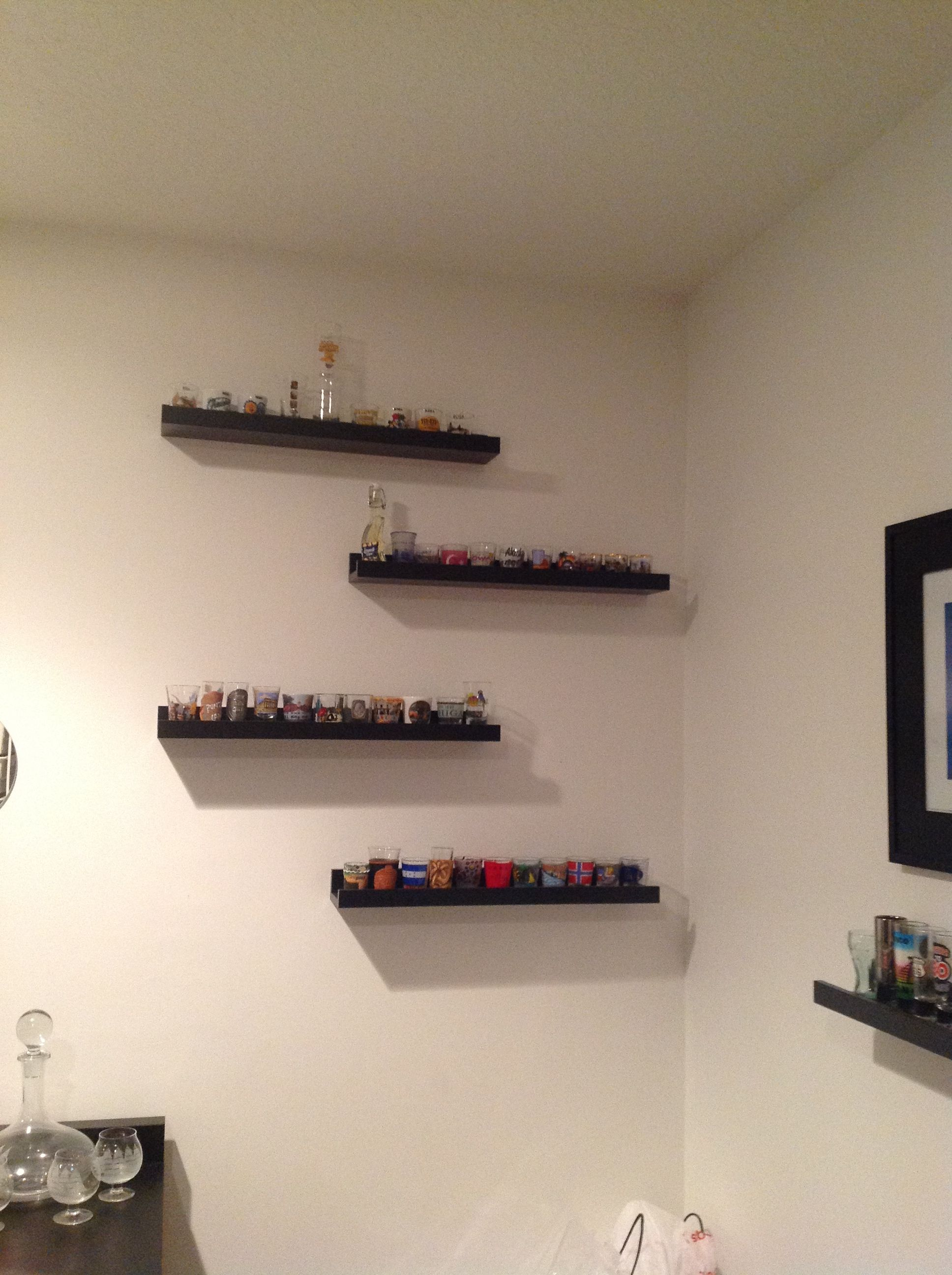 Shelves found in Ikea used for displaying shot glasses