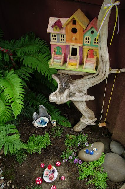 Cute Fairy Garden (They have this unfinished birdhouse at Michaels!)
