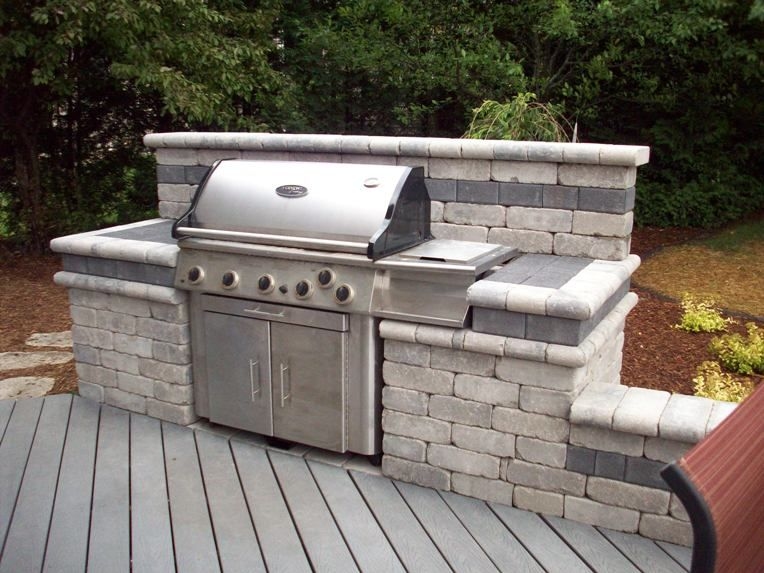 Paver outdoor grilling space outdoor man kitchens for Outdoor kitchen designs for small spaces