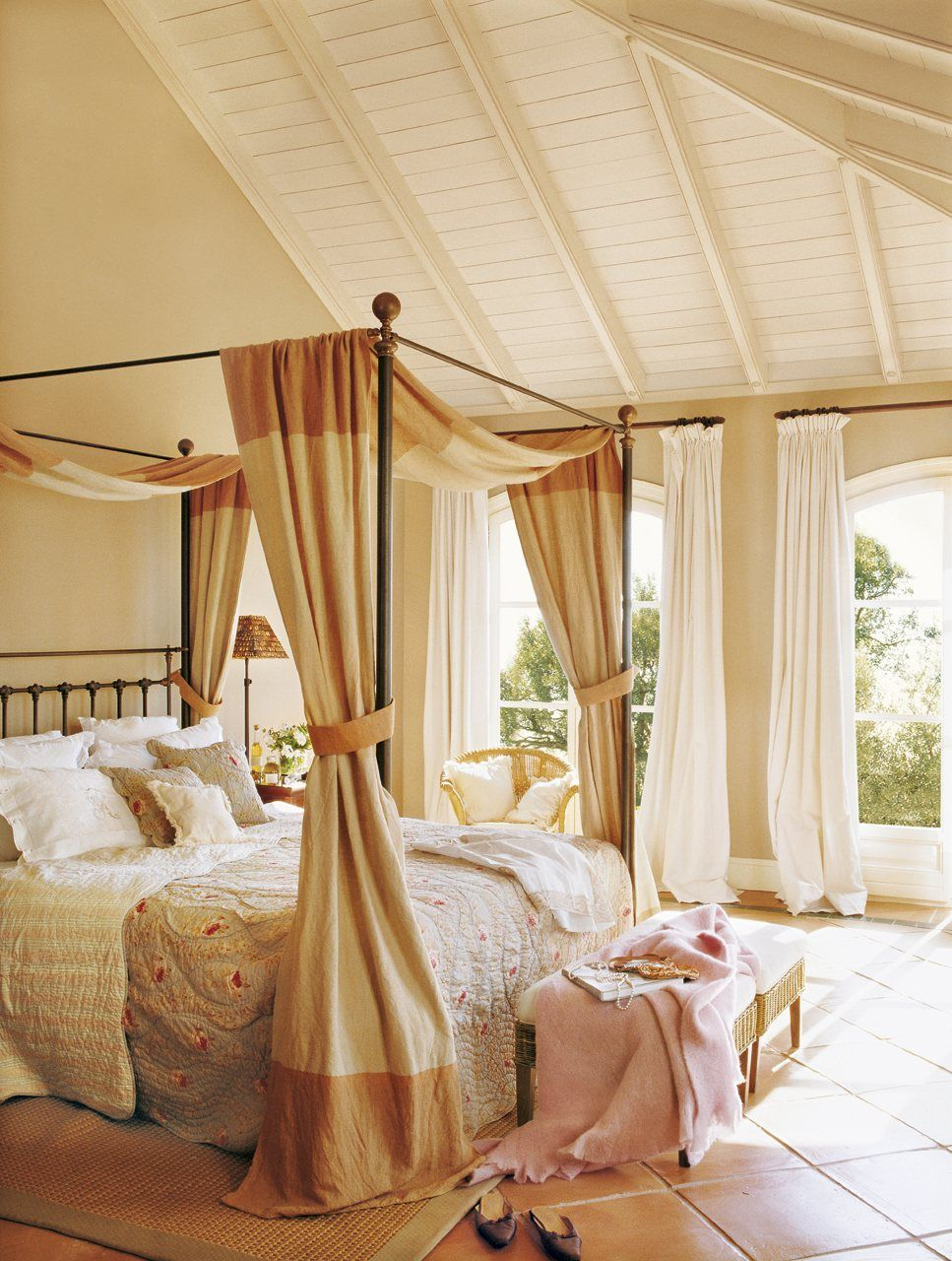 a canopy bed with natural textures and travertine tile floor bedrooms homedecor