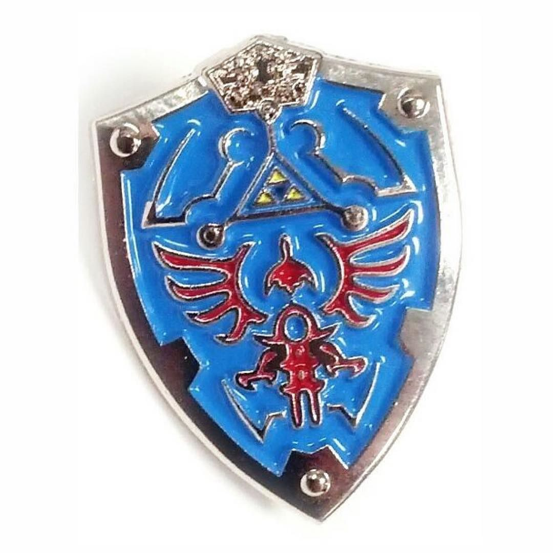 #Repost @wearablecollectibles Zelda Hylian Shield Lapel Pin - 1 inch tall. Polished Nickel plating. Hard Enamel. $10. DM if interested or buy from etsy. Link in profile. Followers appreciated. #jewelry #snescollectibles #wearablecollectibles #geekwear #geekgifts #snes #nes #zeldahearts #legendofzelda #nintendo #supernintendo #retrogames #pixilated #hylianshield #zelda #enamelpin #lapelpin #pinoftheday #lapelpins #pingamestrong #enamelpins #lapelpin (Posted by https://bbllowwnn.com/) Tap the…