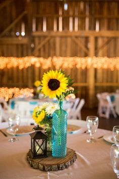 Rustic Fl Centerpiece Turquoise Sunflowers Wedding At Betsy S Barn Photographer Ctg Photography