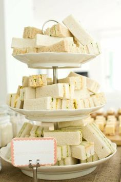 A sweet afternoon wedding reception idea a tiered tray of ribbon ...