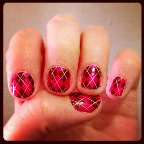 Pink argyle nails.