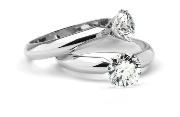Two Diamond Ring On White Background Vintage And Modern