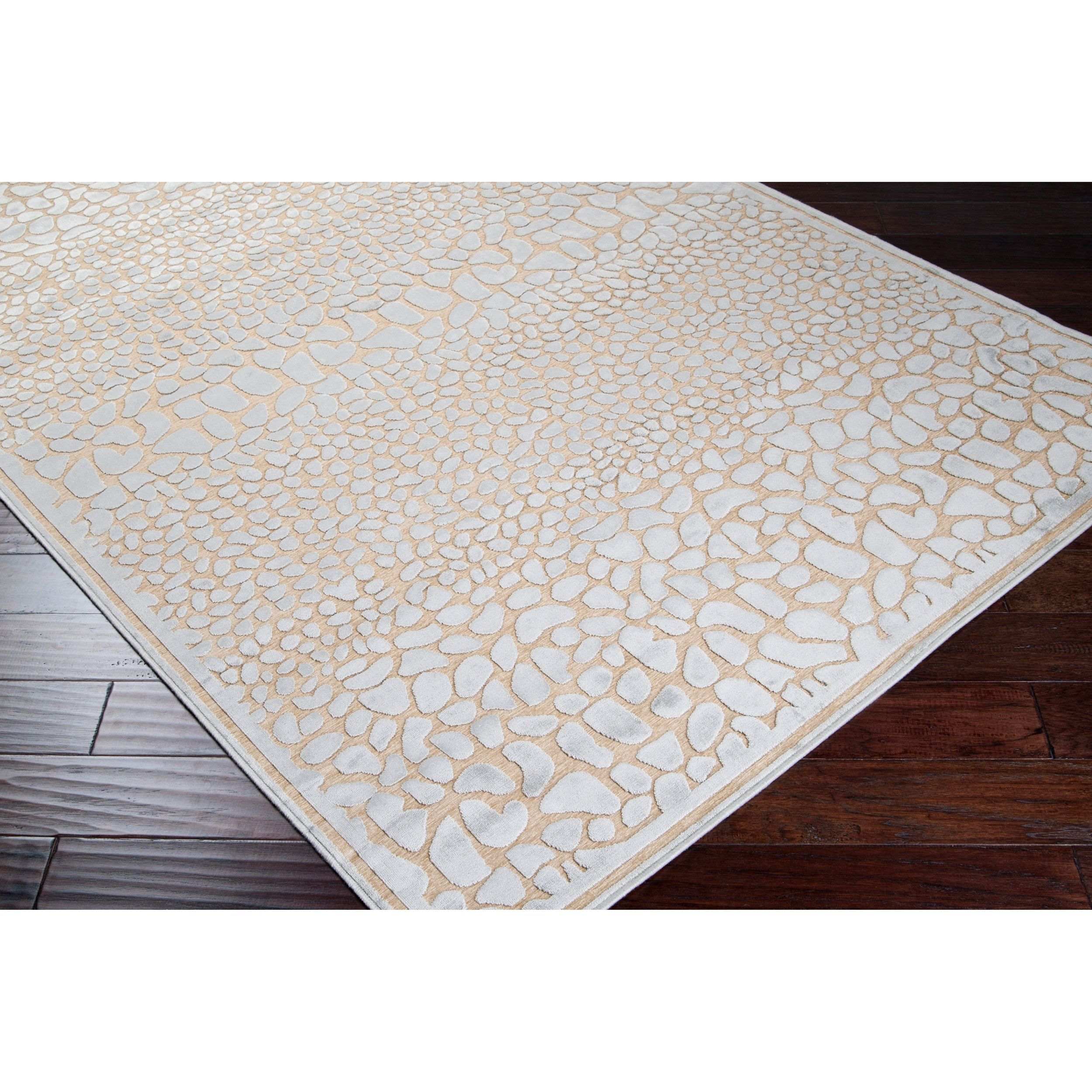Loomed of beautiful viscose and chenille fabric, this rug features and eye-catching leather pattern. A rich tone of light blue completes this brown floor rug.