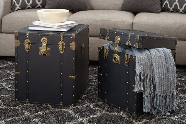 Talk about doing double time. With these two faux leather trunks, you get not only storage capabilities but also handsome display pieces. The studded rivets and brass fixtures are a nice touch.