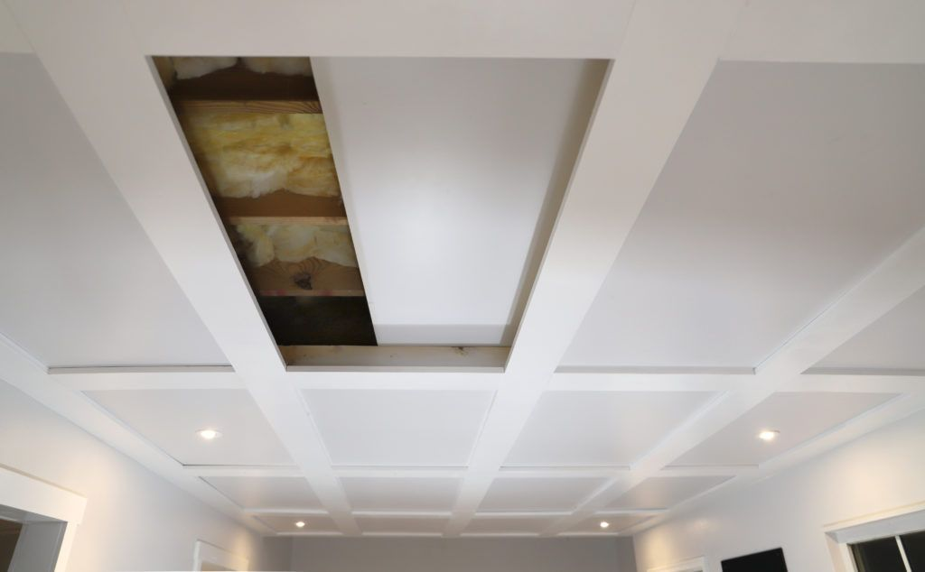 Coffered ceilings with unique hidden access basement