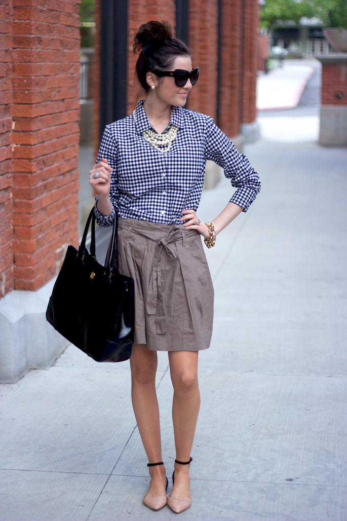Gingham print is a great summer trend. Pair a button-up with a neutral skirt for a work-friendly outfit. #summerfashion #workattire