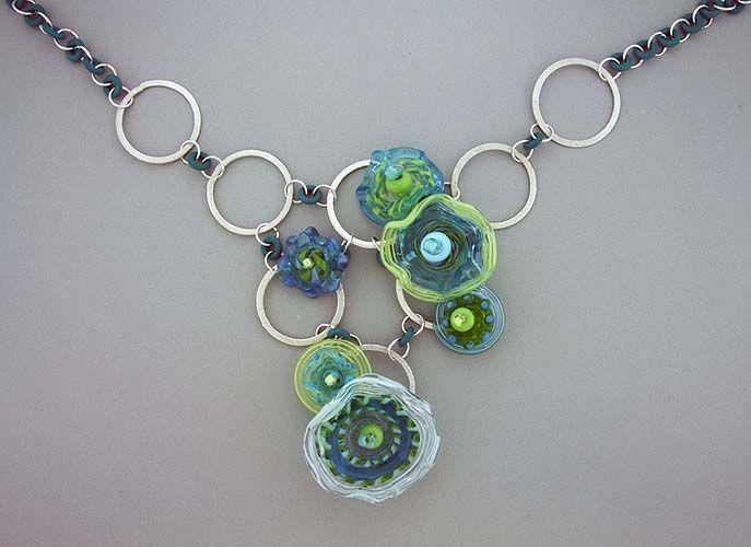 "'Disc Flowers' Neckpiece, Sept 2010: lampworked soft glass beads, Swarovsky crystals, sterling silver beads; 18"" long + 3"" extension  |  Artist:   Elizabeth Hopkins  |  http://www.elizabethhopkinsdesigns.com/"