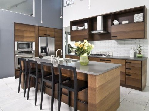 Love the wood cabinets and gray counter tops not sure if they are