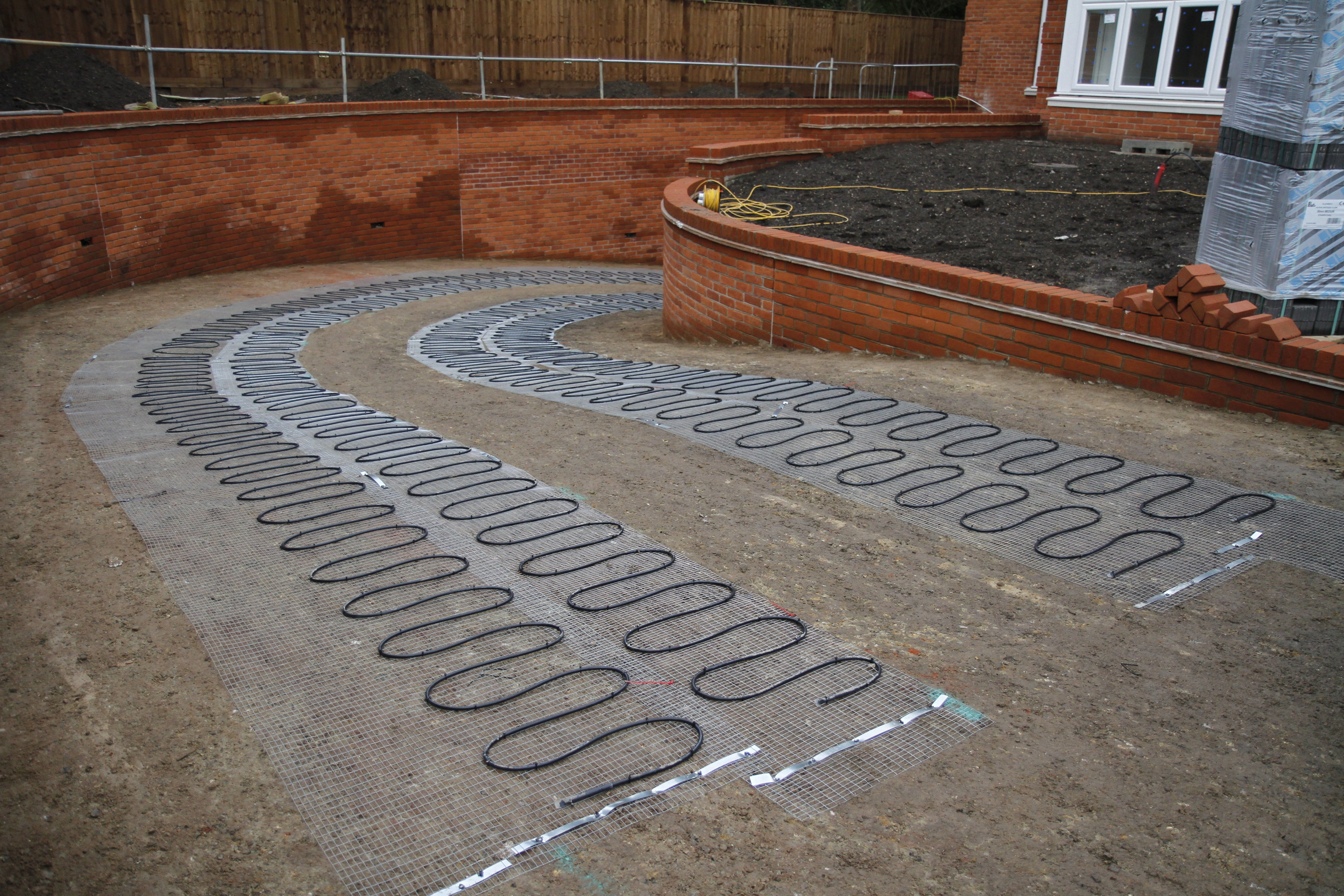 Heated driveway mats fitted with images heated
